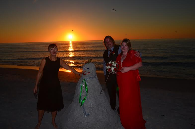 Holiday wedding at Clearwater Beach. Photos by George Sr.