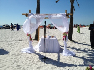 4 post bamboo poles with decorated wtih sand ceremony setup