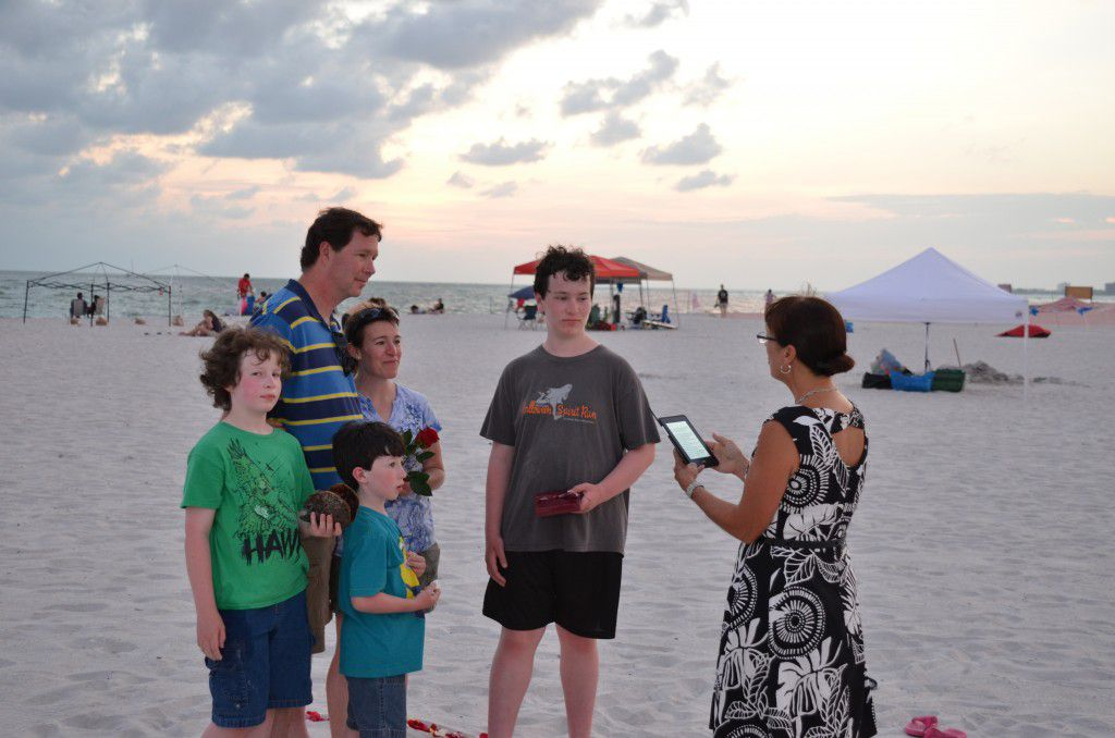 Beautiful vow renewal ceremony while the sun set on Treasure Island Beach