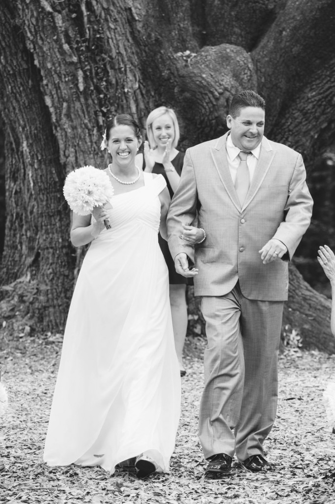 The happy couple walks down the isle after the ceremony. Picture by Ann Hall Photography