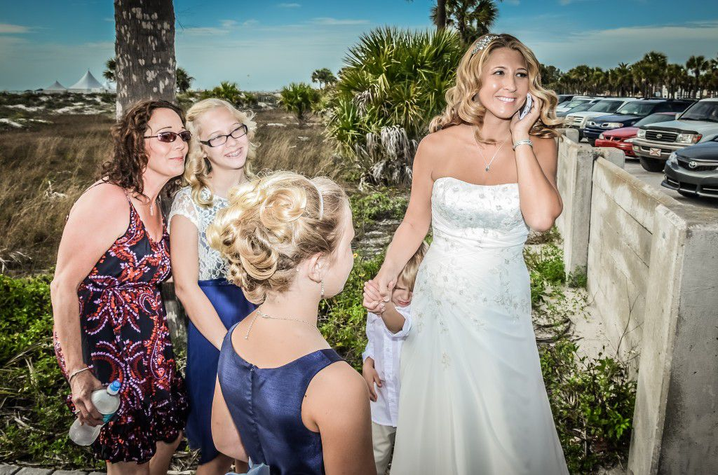 Here is a photo of Cheryl who just getting ready to walk down the aisle, and is still making calls, texting and probably even doing a last minute Facebook post. Photos by George Sr.