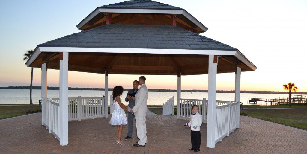 George Jr. performs a sunset wedding in Spanish under the Veteran's Memorial Park gazebo.