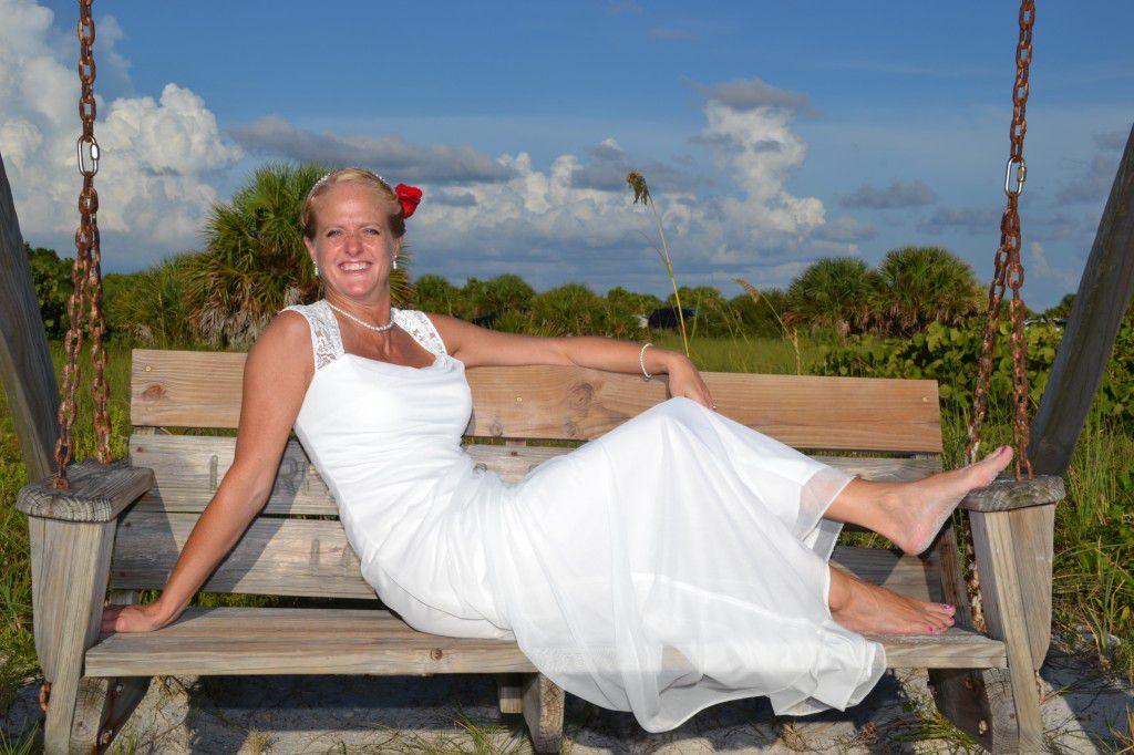 Jen enjoying her casual Honeymoon Island wedding. Photos by George Sr.