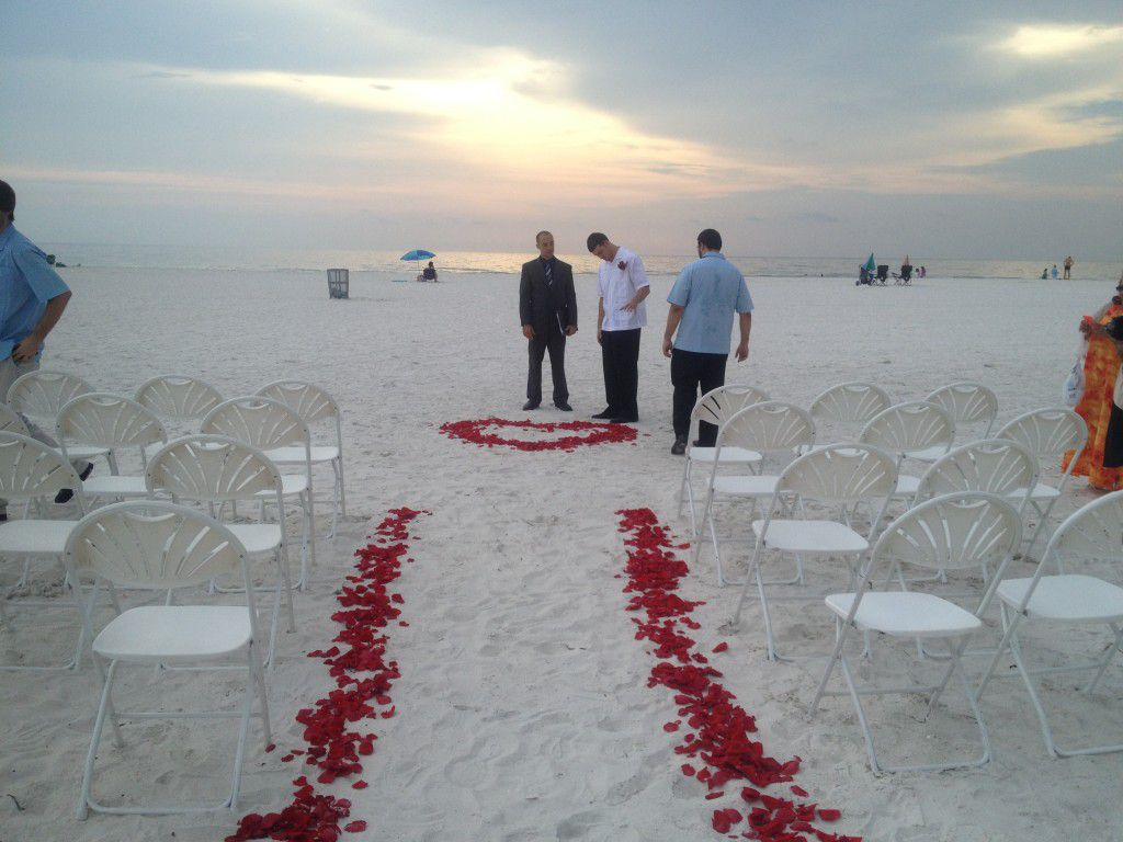 George Jr. getting ready to officiate Lisette and Hernando's Spanish wedding on Clearwater Beach.