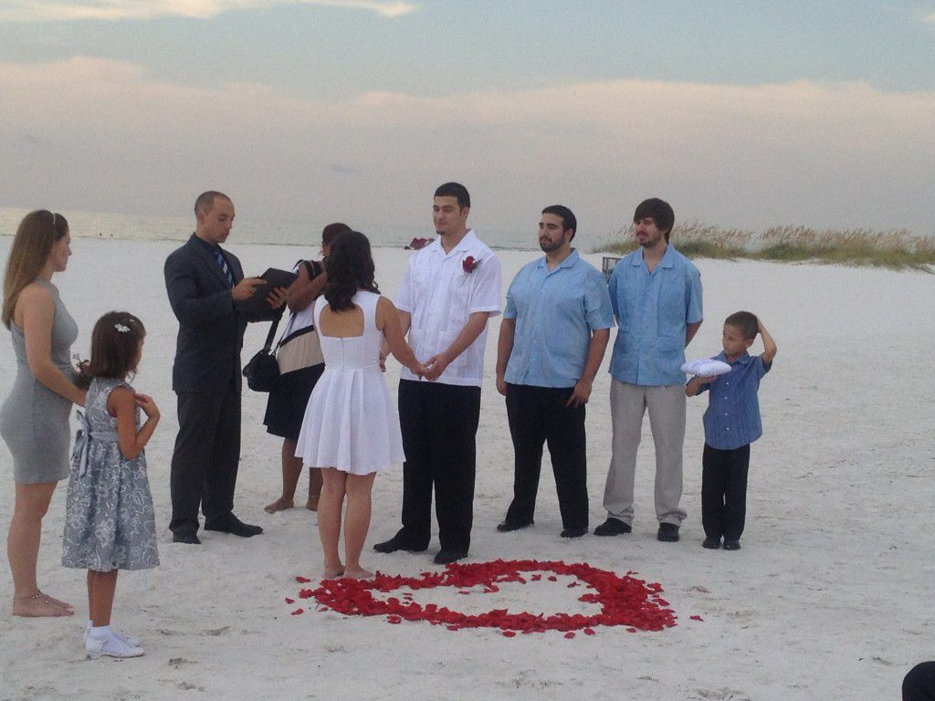 George Jr. performing a Spanish wedding on Clearwater Beach.