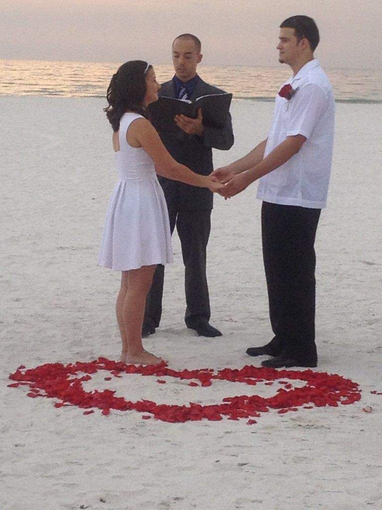 Beautiful evening for a Spanish wedding on Clearwater Beach. The rose petal heart in sand looks great, right?!