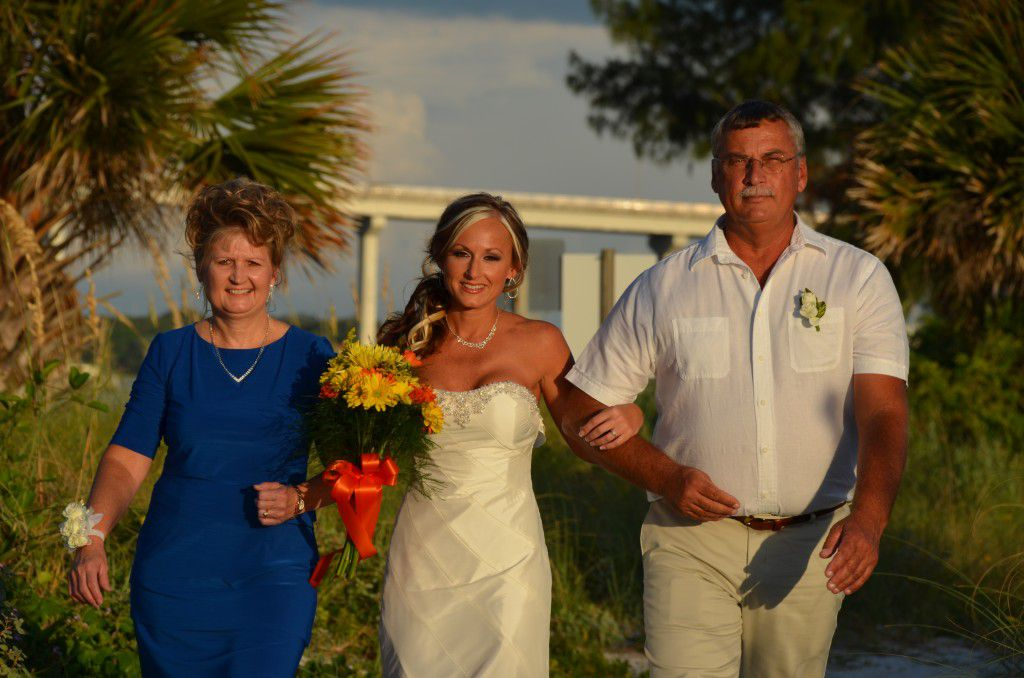 Melissa walking down the beach isle at her Sand Key Park in Clearwater Wedding.