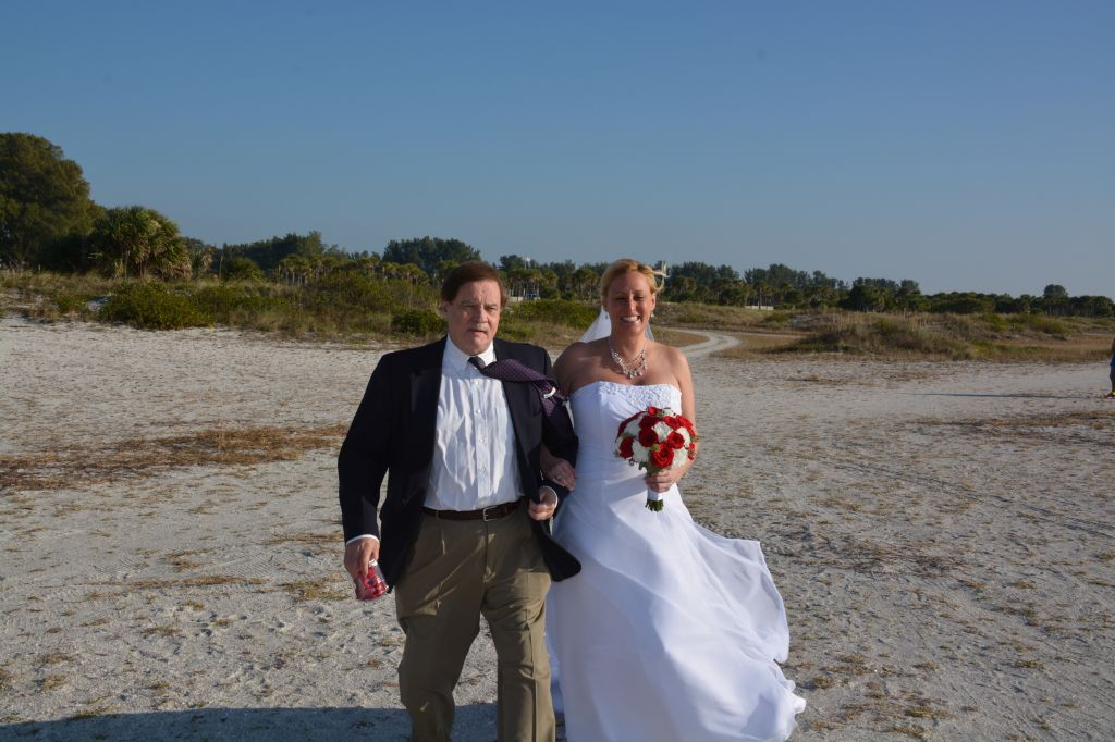 Kristen's Dad walking her down the beach for her Sand Key Park wedding ceremony