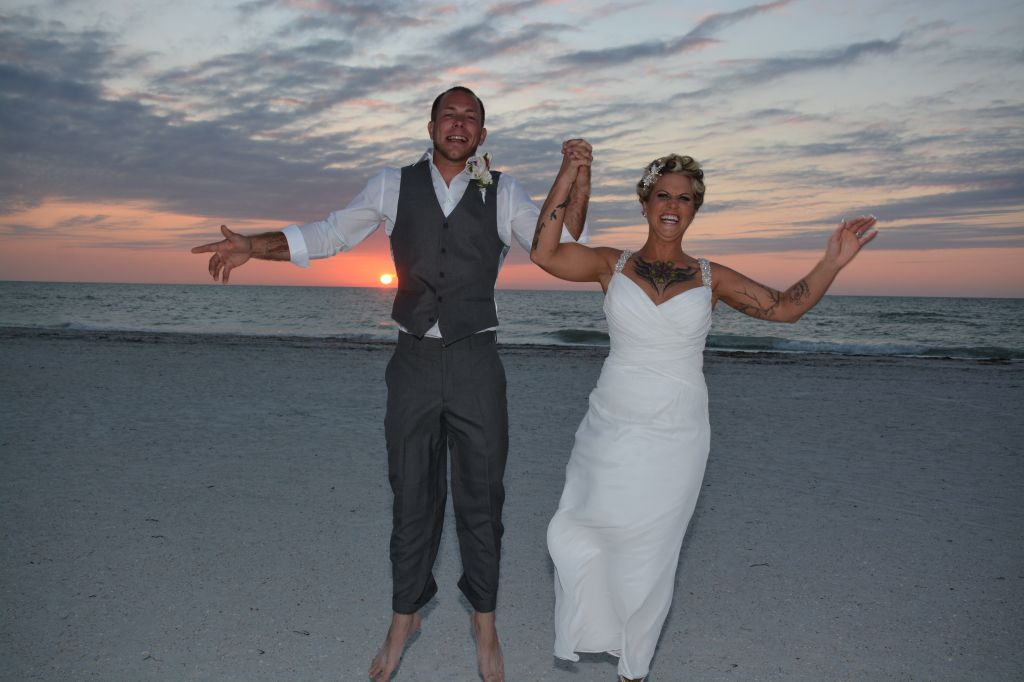 jumping for joy at their Clearwater Beach wedding. Photos by George Sr.