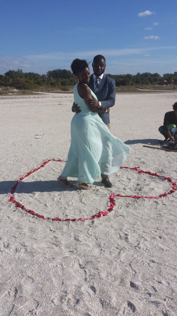 in the rose petal heart at their Sand Key Park Elopement Ceremony