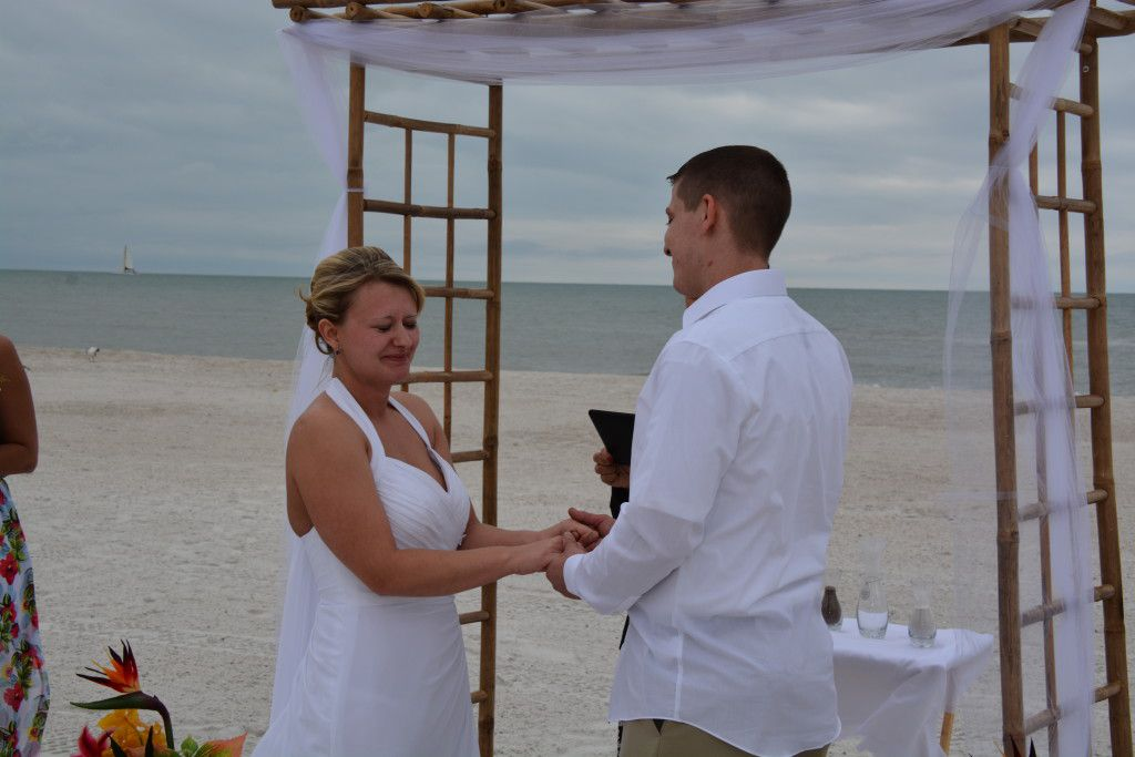 Amber holding back tears of joy during their Clearwater Beach Wedding Ceremony. Photos by George Sr.