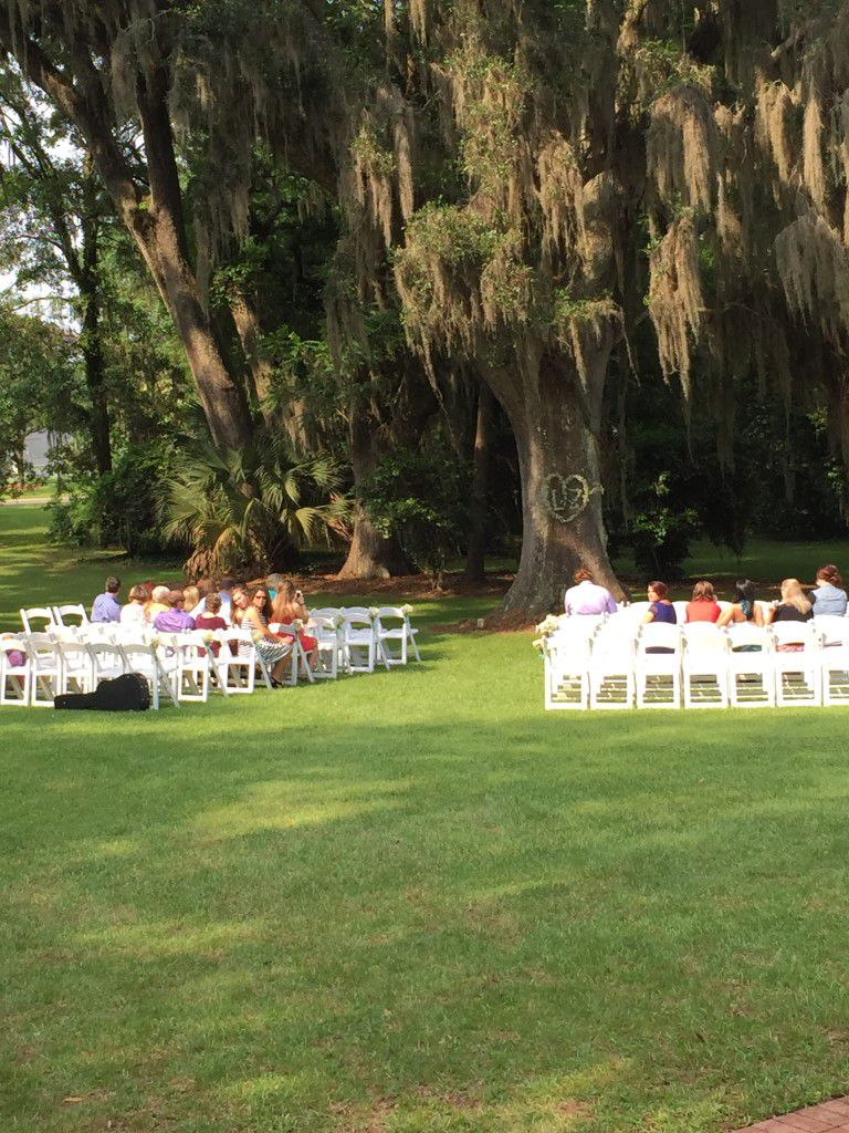 Southwood House wedding ceremony under  the big live oak tree in the front of the house = beautiful
