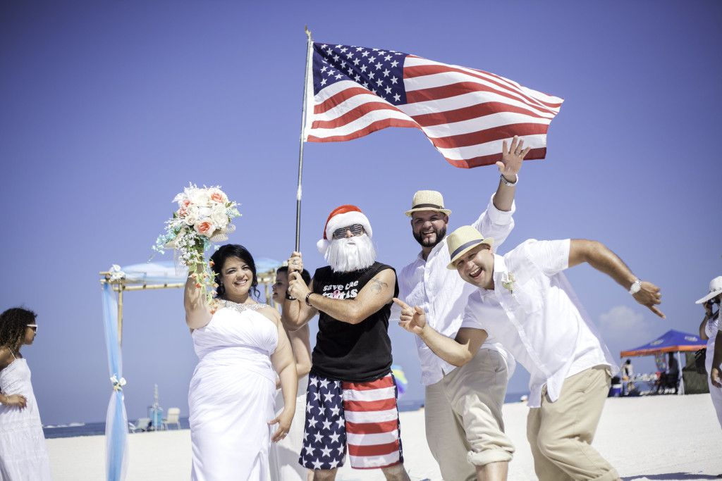 Santa celebrating 4th of July joined Jocelyn and Tito for a fun wedding picture. Picture by C. R. Newman Photography