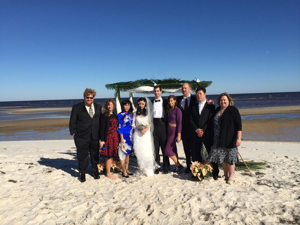 Family and friends gathered for Michael and Willow's chilly Panacea wedding ceremony.