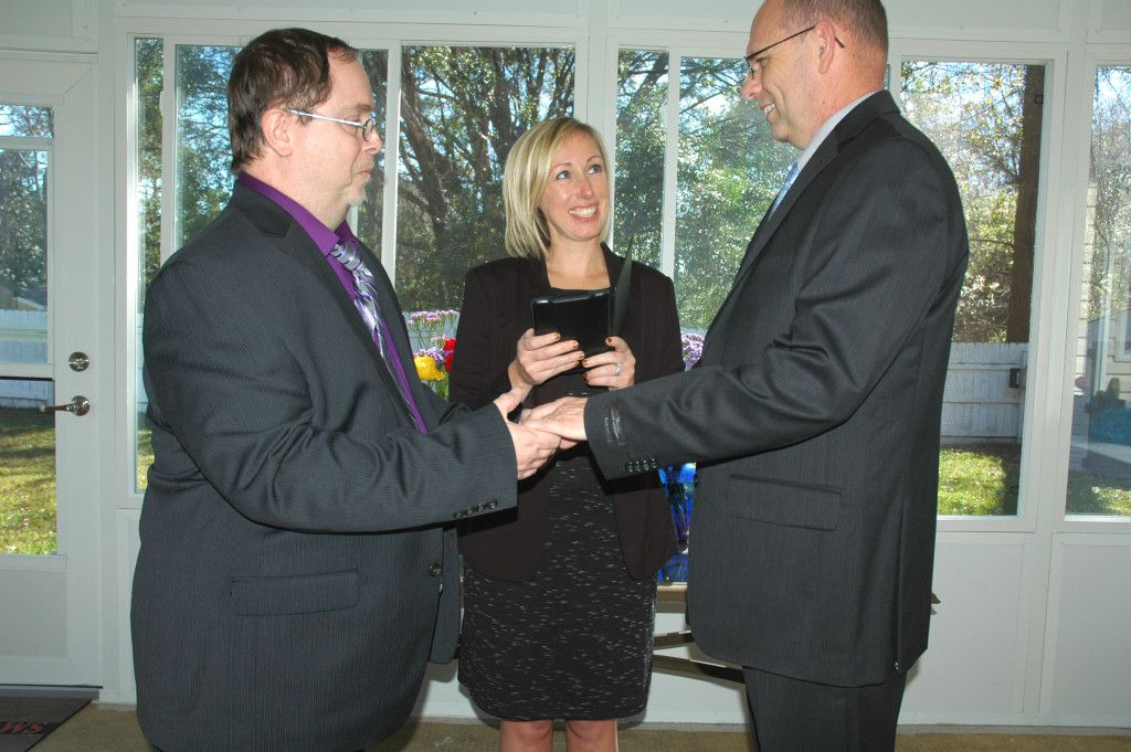 Officiating wedding ceremony in Terry and Roger's Tallahassee home. Photo by Lance Oliver.