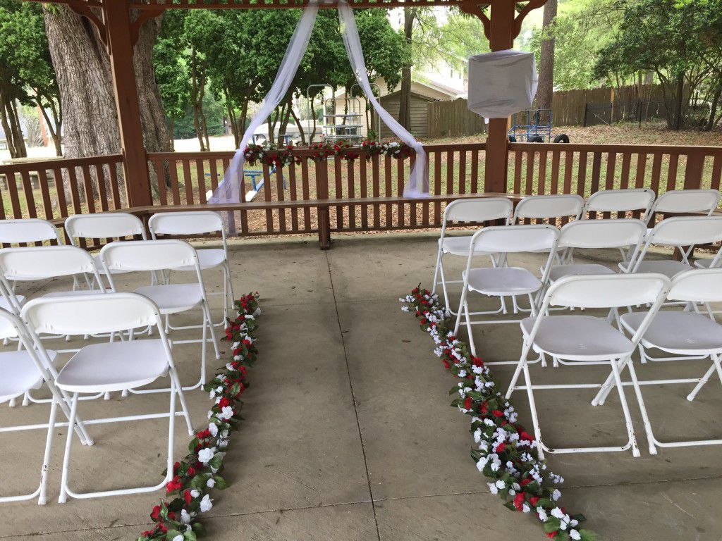 Gazebo all decorated and setup for wedding ceremony.