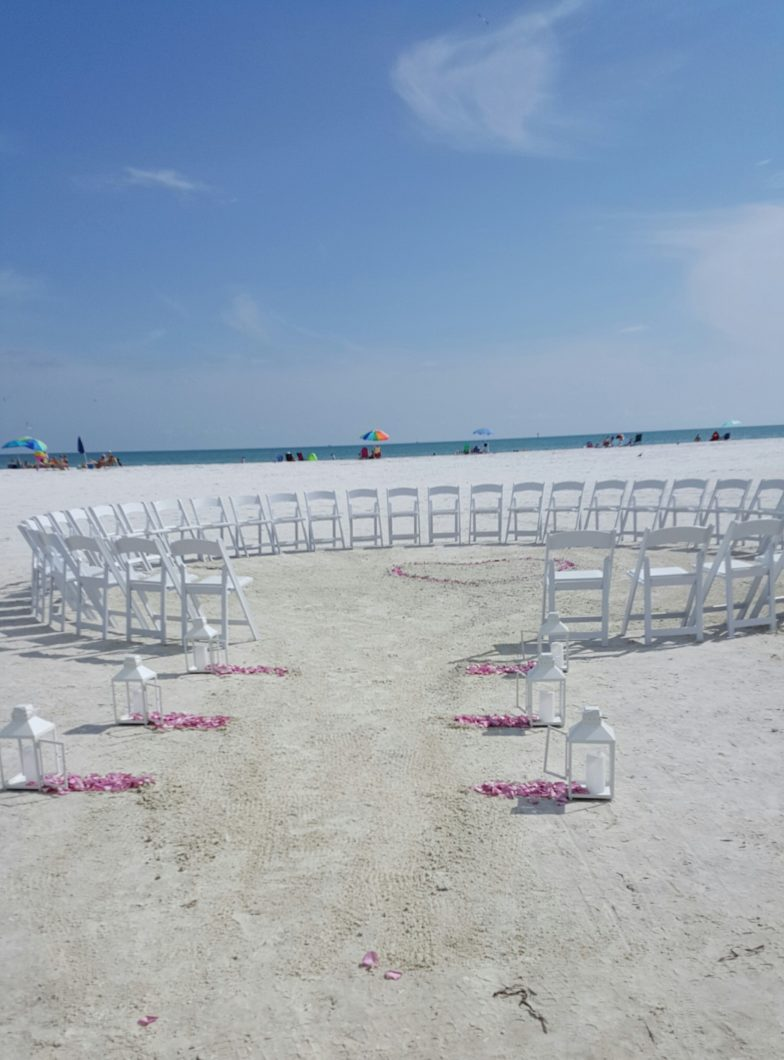 Beach Wedding Ceremony with Circular Chair Setup
