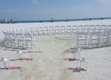 Rose petal heart in center of circular ceremony setup. Siesta Key Beach